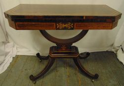 An Edwardian rectangular games table with satinwood inlaid decoration, hinged top on four out