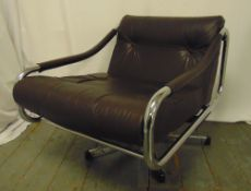 A late 20th century chrome and leather revolving armchair