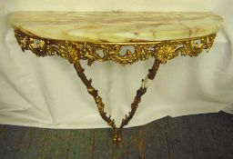 A gilded metal wall mounted consol table with onyx top, 79cm (h)