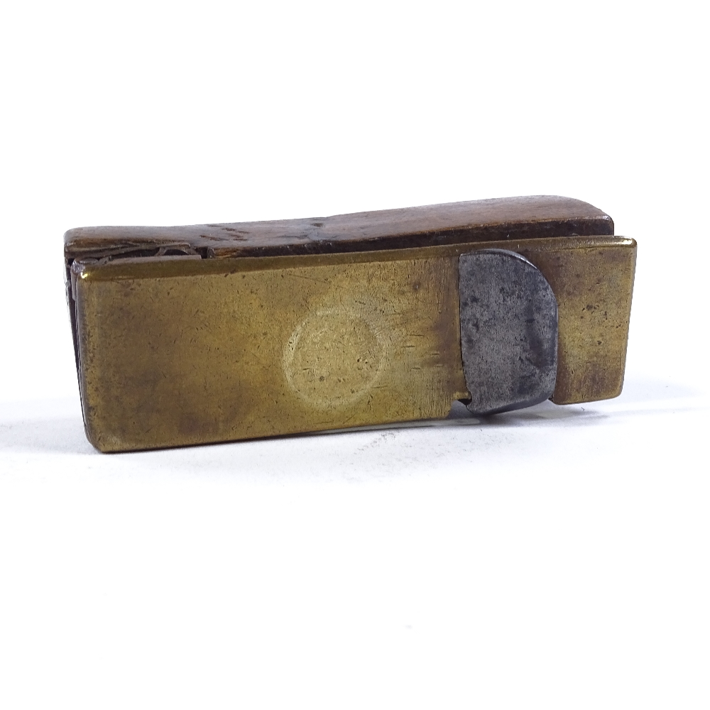 Lot 48 - 18th century wood working plane with bronze sole, stamped GP 1790, length 10cm Several splits in the