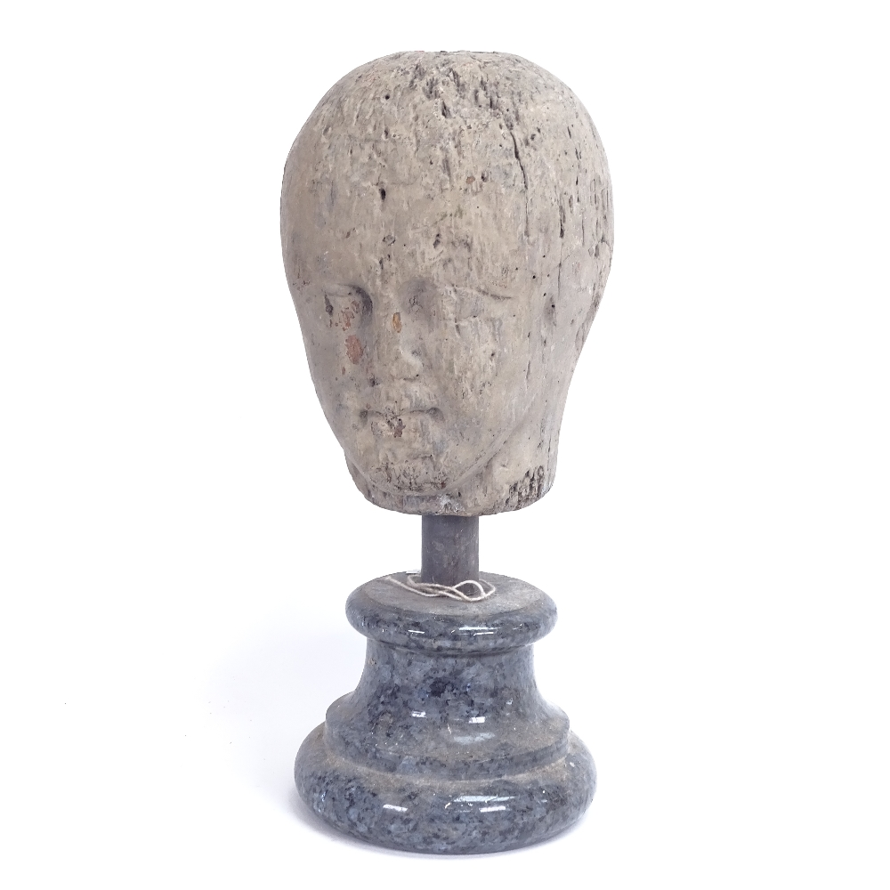 Lot 8 - A 19th century carved and painted wood head sculpture, unsigned, on modern marble plinth, overall