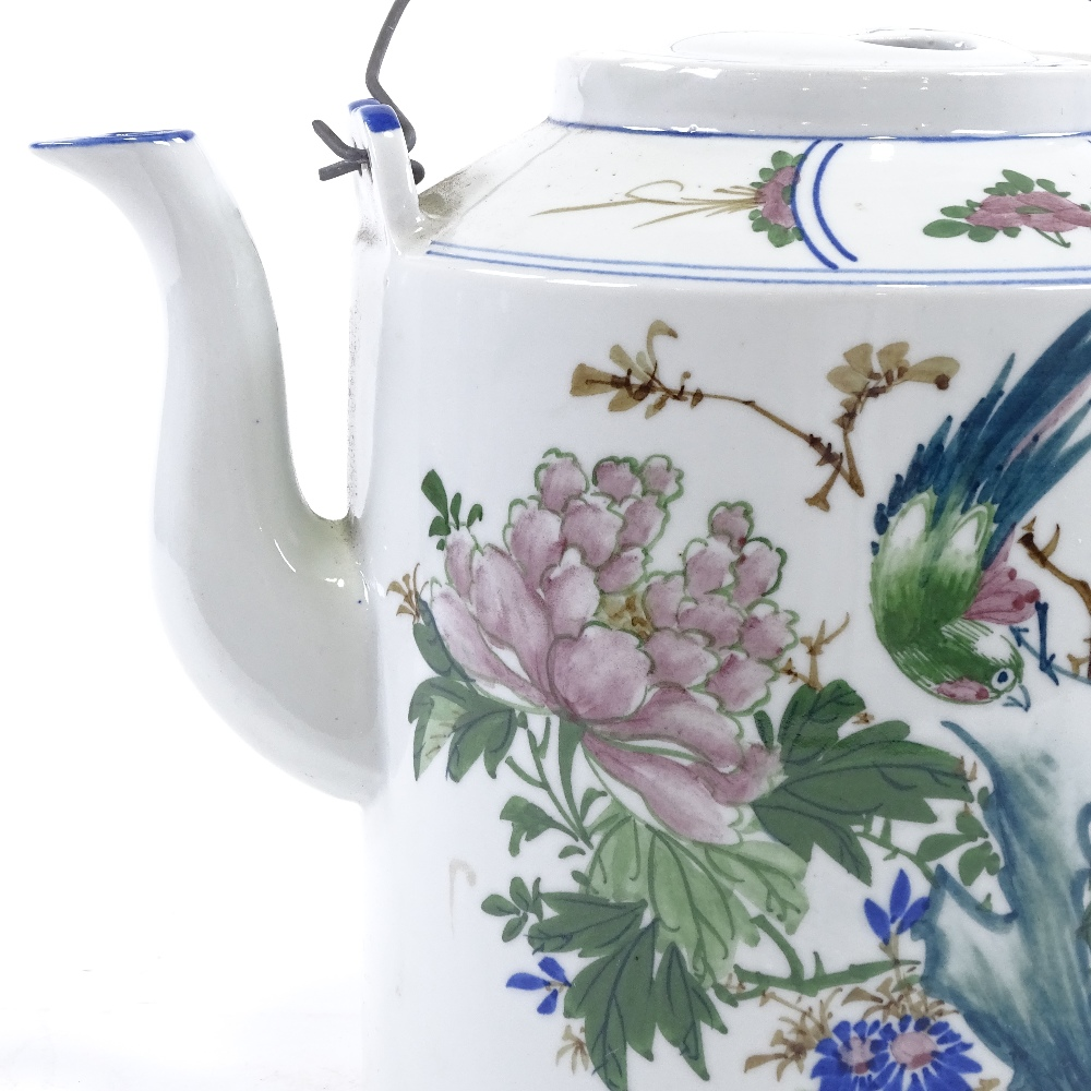 Lot 50 - A large Chinese porcelain teapot, hand painted decoration and wire handles, height 24cm, modern