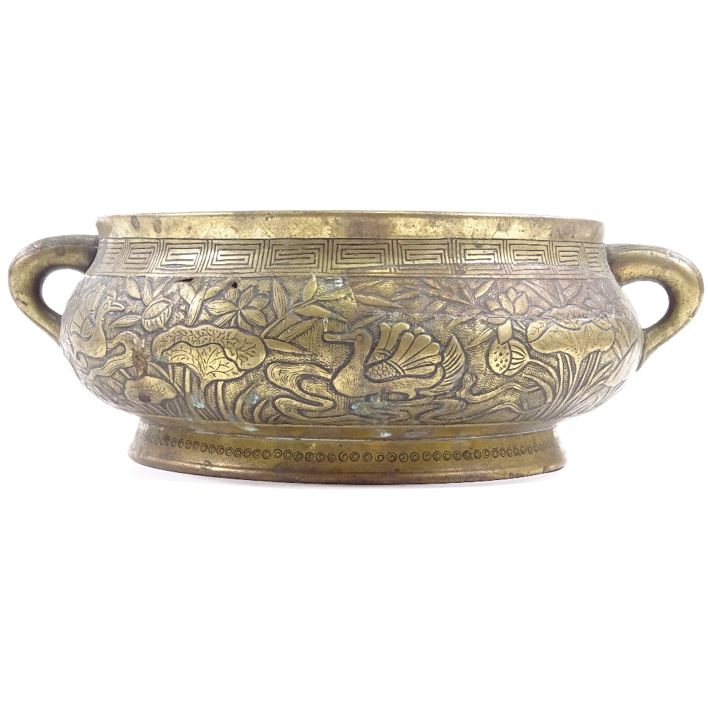 Lot 26 - Antique Chinese polished bronze 2-handled incense burner, relief cast duck and lily decorated