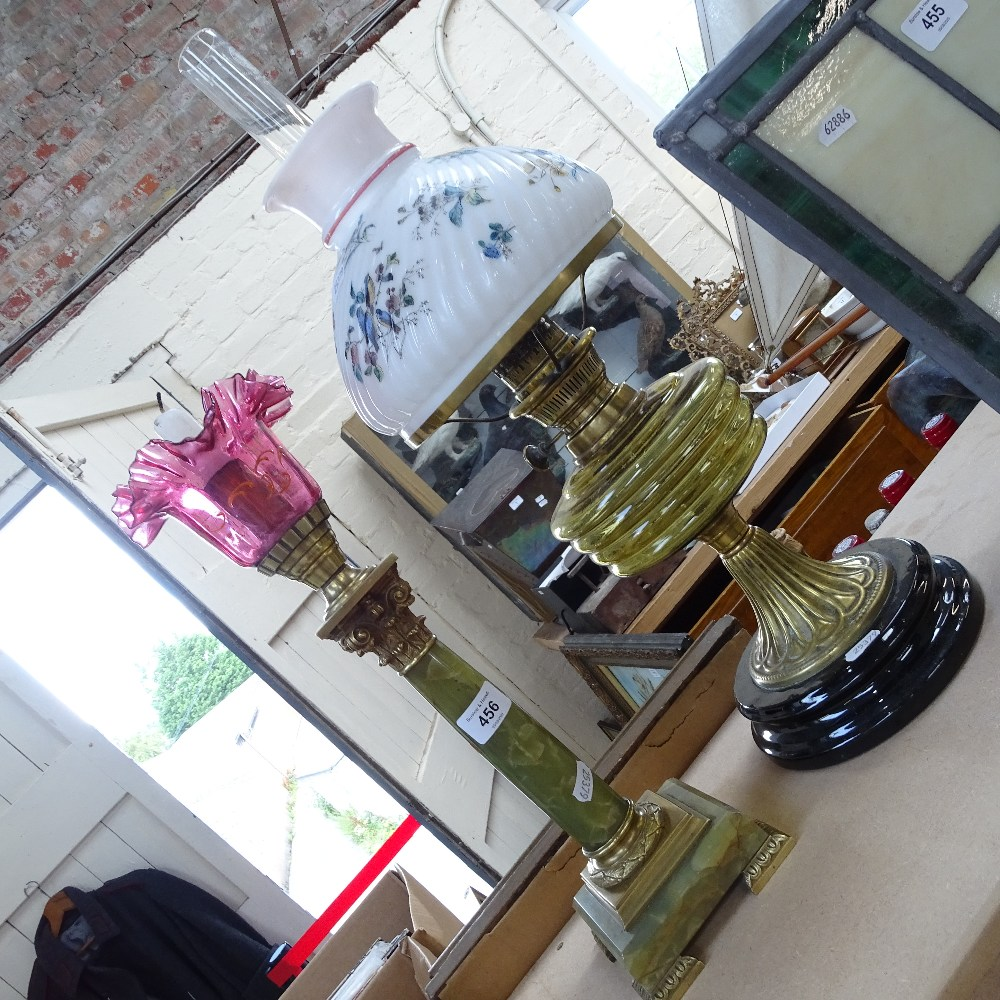 Lot 456 - An onyx and brass Corinthian column candlestick, and glass and brass Duplex oil lamp, largest height
