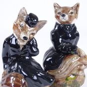 A pair of Staffordshire China hunting foxes in black coats, height 19cm Perfect condition