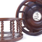 A pair of lignum vitae ship's decanter coasters, with delicate barley twist spindles and inset