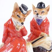 A pair of Cooper Craft Staffordshire China hunting foxes in red coats, height 19cm Perfect condition