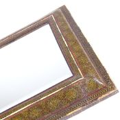 An Islamic micro-mosaic and ivory inlaid cushion-framed mirror, with inset bevelled glass, the