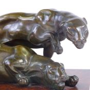 An Art Deco period patinated bronze group of 2 prowling panthers, on original amboyna plinth,