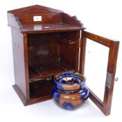 A table-top oak smoker's cabinet, with glazed tobacco jar, cabinet height 38cm