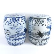 A pair of Chinese blue and white porcelain barrel garden seats, pierced panels with figural and