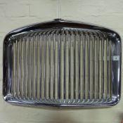 A Vintage chrome Austin Vanden Plas Princess Classic car radiator grille, with red enamel crown
