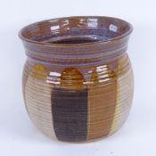 A Canterbury Pottery slip glazed vase, height 22cm
