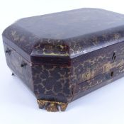 An Antique Chinese export gilded black lacquer octagonal workbox, court scenes with floral borders