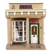 A handmade Victorian Townhouse design doll?s house, containing various accessories, furniture,