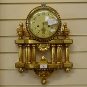 A modern German giltwood 8-day wall hanging clock, cream dial with Arabic numerals, and a pillar