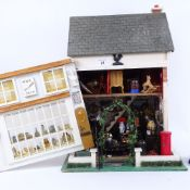 A handmade village shop design doll's house, containing various accessories, furniture, ornaments