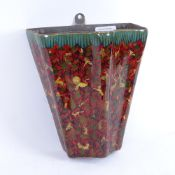 An Indian Kashmir lacquered and hand painted papier mache wall pocket, made by Suffering Moses