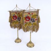 A pair of 19th century Berlin beadwork face screens, mounted on original gilt-brass stands on relief