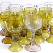 A set of 8 handmade Venetian glass goblets with gilded trailing design, height 11cm, and a set of