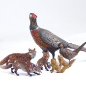 A large cold painted bronze pheasant, length 19cm, together with a group of smaller cold painted