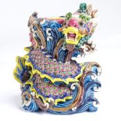 A Chinese glazed ceramic dragon design candle stand, impressed marks under base, height 14cm The