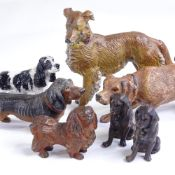 A group of cold painted bronze and metal dogs, including bronze Spaniel, length 7cm, bronze