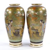 A pair of Japanese Satsuma porcelain vases, mid-20th century with hand painted and gilded