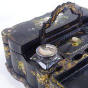 A Victorian papier mache writing box with carrying handle, allover hand painted and mother-of-