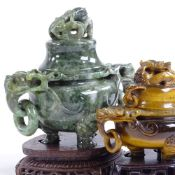 A Chinese relief carved tigers eye censer and cover, with dragon design ring handles, original