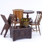 A group of doll's furniture, including a 1930s panelled coffer, width 24cm, 2 tilt-top dining