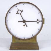 JOSEF HOFFMANN - an Austrian brass-cased table clock, designed before 1928 and executed by the