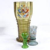 A large Continental amber glass vase with painted enamel armorial crest and applied twist