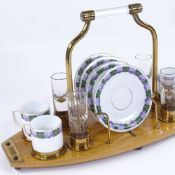 A German coffee and schnapps set, circa 1920s, transfer printed china and cut-glass on original
