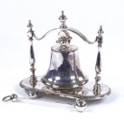 An electroplate table bell on stand, circa 1900, with original plated clapper, height 15.5cm, length