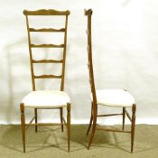 A pair of mid-century Italian Chiavari exaggerated high back chairs, with shaped ladder backs
