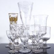 A group of mainly 19th century glassware, including a large funnel shaped goblet with wheel-cut wild