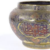 A large Islamic brass jardiniere, probably late 19th century with silver and copper inlaid