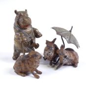 A miniature cold painted bronze caricature hippo with a walking stick, unsigned, height 5cm, and a