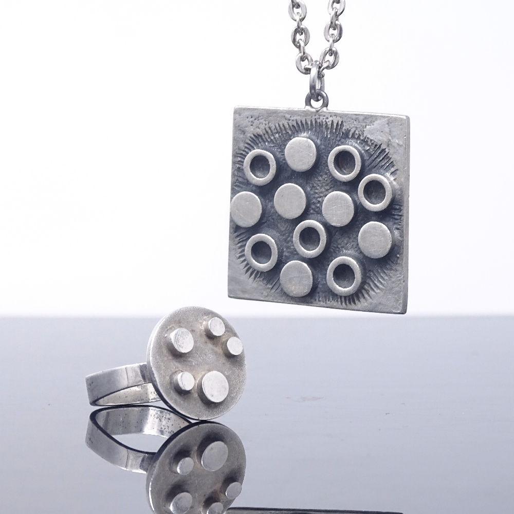 Lot 8 - R TENN - a Swedish pewter modernist abstract pendant necklace, and a similar stylised silver ring