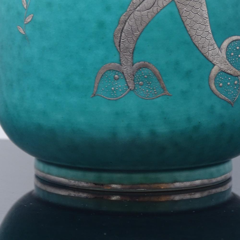 Lot 124 - WILHELM KAGE FOR GUSTAVSBERG - a mid-century Swedish green glaze ceramic Argenta vase, circa