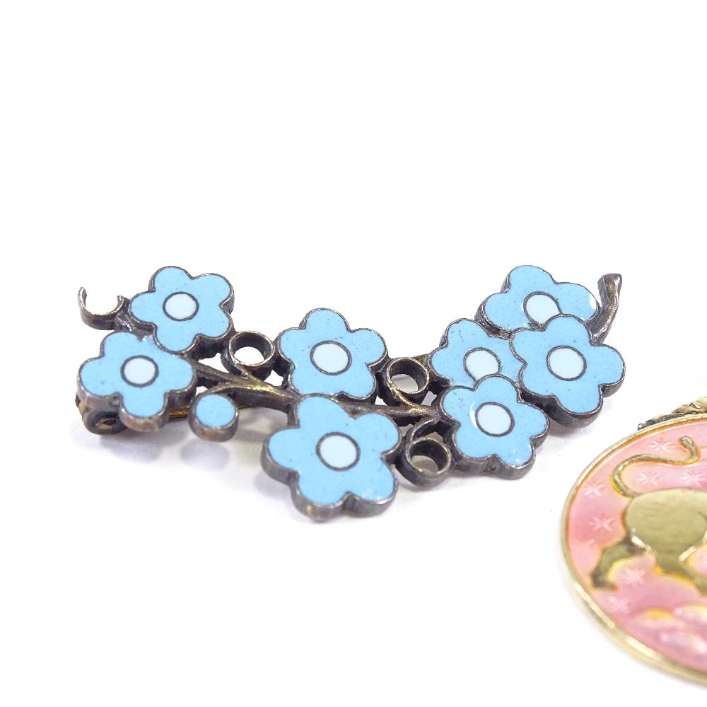 Lot 7 - ANTON MICHELSEN - a Danish vermeil sterling silver and blue enamel floral brooch, brooch length 34.
