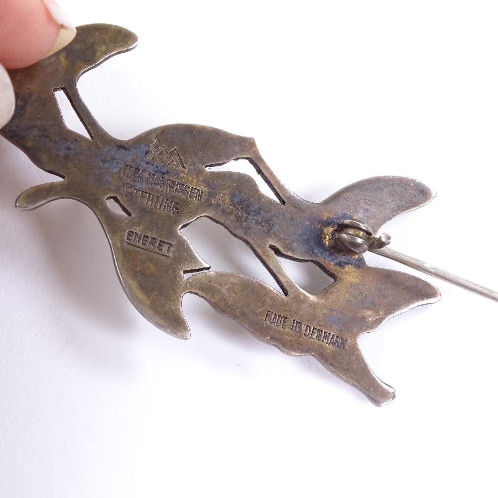 Lot 5 - ERIK MAGNUSSEN - a Vintage Danish vermeil sterling silver and enamel flying geese brooch, brooch