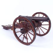A scratch-built model field cannon with bronze barrel, on metal-mounted wooden carriage, barrel