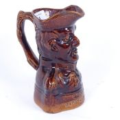 A 19th century treacle-glazed stoneware pottery jug commemorating the Duke of Wellington, died
