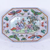 A Chinese octagonal hand painted ceramic plate, with butterfly surround and mark underneath,