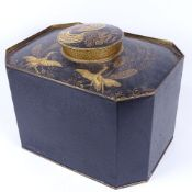 A reproduction Toleware caddy of canted rectangular form, with hand painted gilded exotic birds,