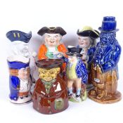 A group of 19th century English pottery Toby jugs, and a Fulham Pottery figural decanter, height