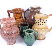 A group of 5 19th century pottery puzzle jugs, including slip glaze and salt glaze, largest height