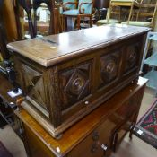 A French crossbanded and panelled oak coffer on bun feet, W99cm, H46cm, D35cm